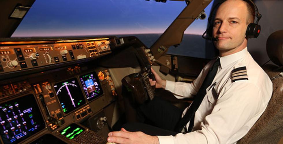 Mark Vanhoenacker in the cockpit of a Boeing 747-400.