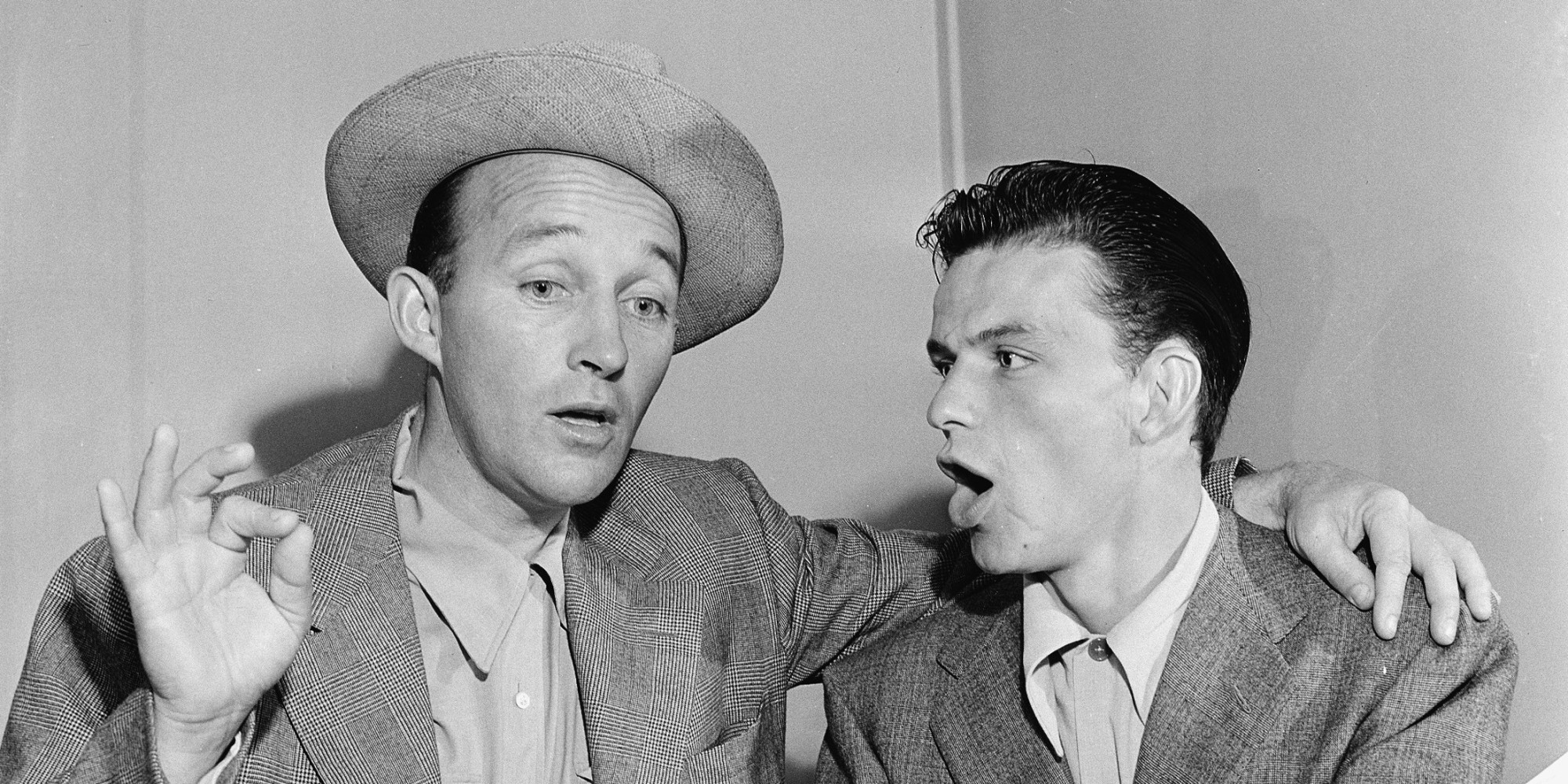 Bing Crosby, left, and Frank Sinatra break out in song in Bing's dressing room between radio programs in Hollywood, Ca., Sept. 12, 1943.  (AP Photo)