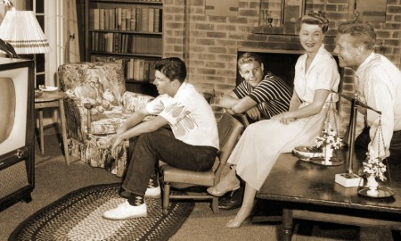 The Nelsons - Rick, Dave, Harriet and Ozzie - watching their own show at home, ca. 1960s
